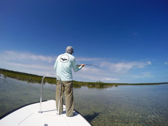 Mike with a bonefish hooked and playing.